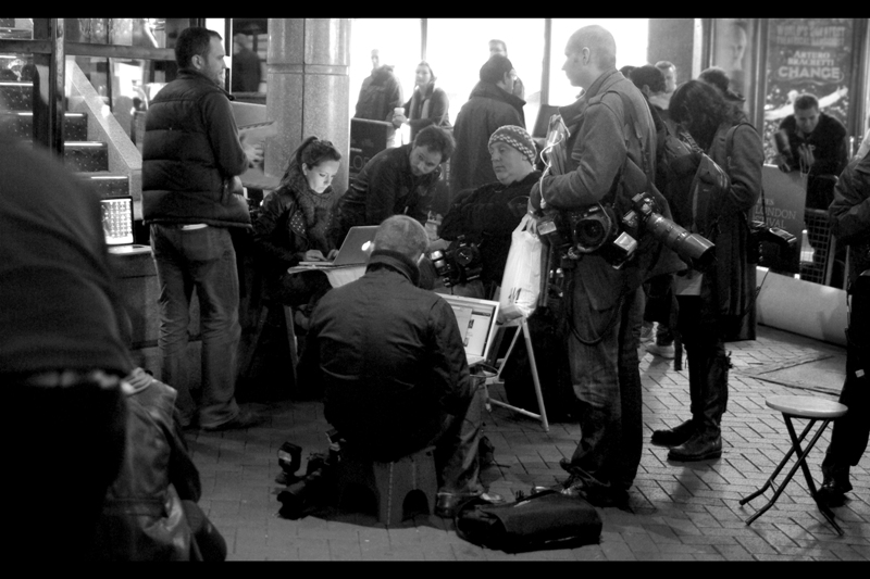 The photographers from the Dead Man Running premiere basically packed up their gear and crossed Leicester Square en masse and found places to sit down and upload their pictures while their 'press pen' was constructed