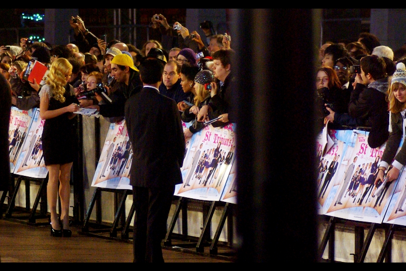 Yellow Cap Guy shoots! Yellow Cap Guy Scores! Not only does nobody really, truly know who Clara Paget is, but he's now got her autograph and made what I hope is a connection. Well done!
