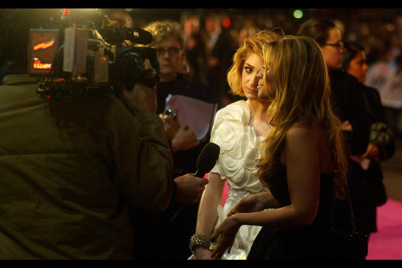 "Nicola Roberts:  ""Babe, it CAN'T be seven o'clock in the evening, because if I'd been sleeping for over nineteen hours, I would have known about it. Although, why are there so many people here for a three o'clock in the morning film premiere?""  Kimberley Walsh (fellow bandmember in front of her) :  ""Because it *IS* seven in the evening, Nicola…""  Nicola Roberts :  ""Babe are you even LISTENING to me? I said…""  [photo taken here]"