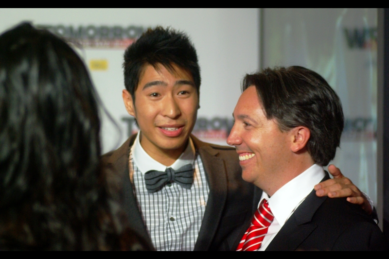 This is/may be Chris Pang, whose bow tie clearly implies he knows that ice, being less dense than water, would float if you blew up an arctic base.  Oh, dear lord, the director also wrote the screenplay for the third Pirates of the Caribbean film. That one made no sense either.. .