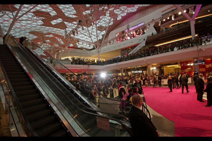 Location : Westfield Shepherds Bush. Given forecasts of rain, not the worst place for a premiere. Given the white balance issues created by a PINK carpet? Maybe a little less so. (My position next to the escalators was highly strategic.)