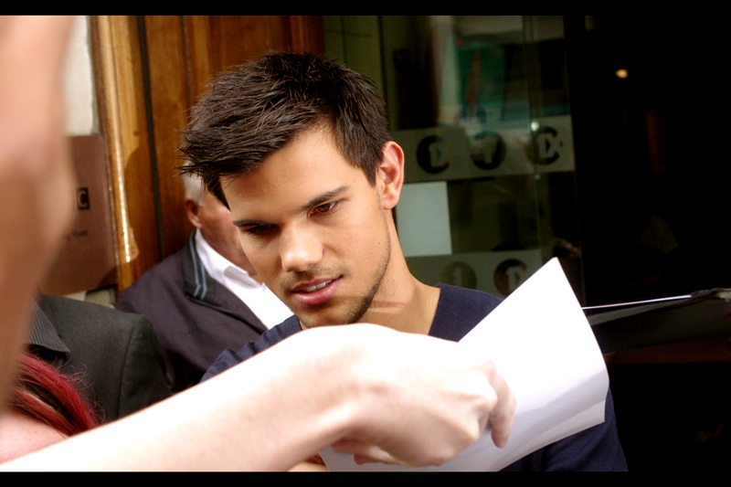 """""""Shhhh, man! It's getting to the good bit!"""" . Twelve minutes later, and security are trying to move Mr Lautner on and the paparazzi are getting restless."""
