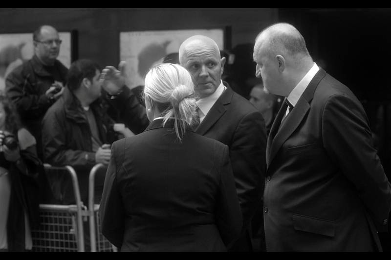 A young Anthony Hopkins As Hannibal Lecter appears to be in charge of security at this event. The company that usually does security at premieres wasn't at this one - they were at the World Premiere. This would prove to have interesting (but not bad) consequences later.
