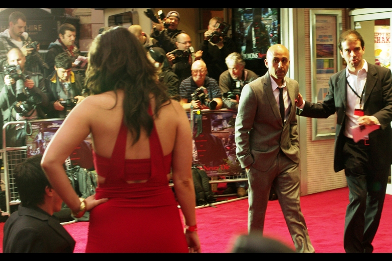 """""""Neo, are you listening to what I'm saying or are you too busy staring at the woman in the red dress?""""  This man is not Keanu Reeves, and the usher is not Laurence Fishburne. And that's all I know. (Further research says' he's Arjun Rose, and he's the director of this film) (you're welcome)."""