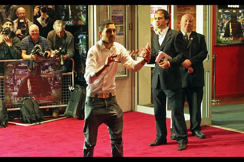 """Stop everything! A man has just done a card trick ON the RED CARPET! And, insanely, neither getty images nor wireimage tagged him. (And, to add incredulity to insanity, I was asked by two people upon leaving the premiere whether  """"Dynamo""""  had already gone in!) ...That's right. His name is  """"Dynamo"""" . Well, Sir, my name is  """"Rizzle Kicks""""  (What do you mean that name's already taken??)"""
