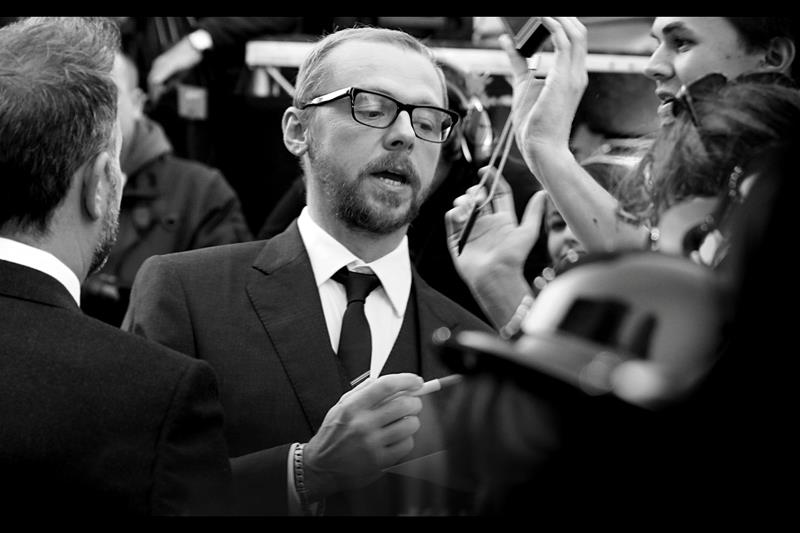 Simon Pegg is the voice of either Thomson or Thompson, as well as Scotty in the new Star Trek, Shaun in Shaun of the Dead.Very cool - love the glasses.