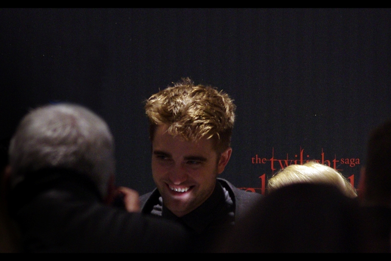 Way off in the distance, between peoples' heads and around other peoples' heads / posters / signs / mobile phones... I manage to get a long-range shot of R-Patz, teeth gleaming, as the trio are photographed against a backing wall. Is that it, then? Are they going to head for the cinema....?