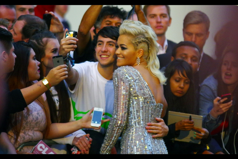 But it's not Rita Ora, here being photographed by a guy taking  a photograph of her.