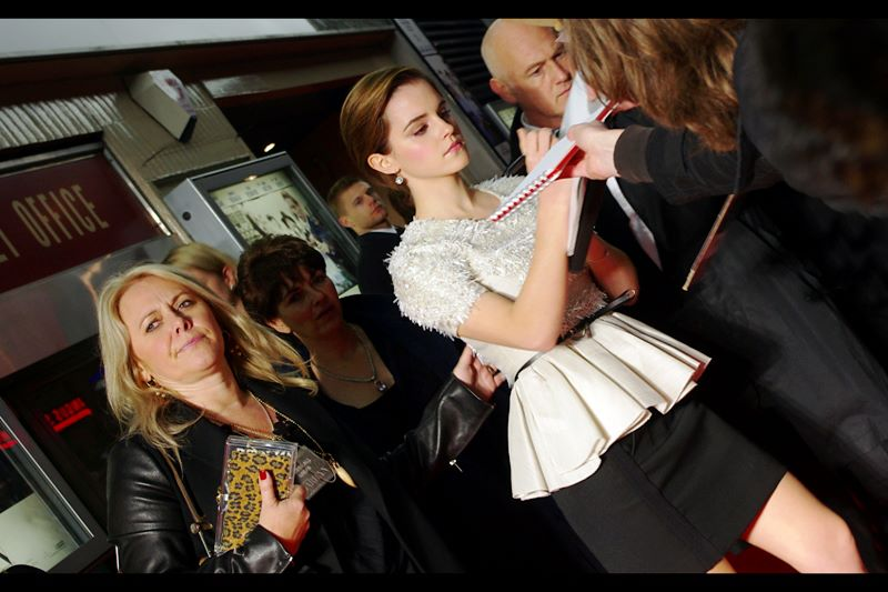 In order to save time, it appears Emma Watson has an animatronic waxwork statue mounted on a skateboard to halve her autograph signing duties. Smart!