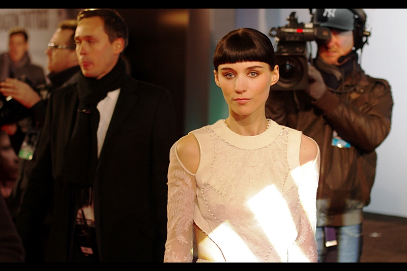 Rooney Mara, among other roles, played the character Erica Albright in 'The Social Network'. It was a short but memorable role - same director. On which note, given this is a world premiere, where IS the director?