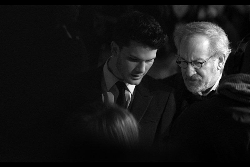 Jeremy Irvine and Steven Spielberg : Director and main star converse. Something about a dicey real estate scheme? Who knows...