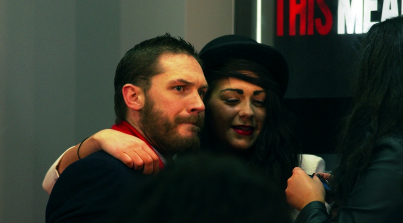 Meanwhile, elsewhere, I always feel that Security Guards spend far too much time looking for (Male) Threats To Stars among the crowd, while leaving 'harmless' (?) females to interact with minimal interference. Tom Hardy looks like he wants OUT.