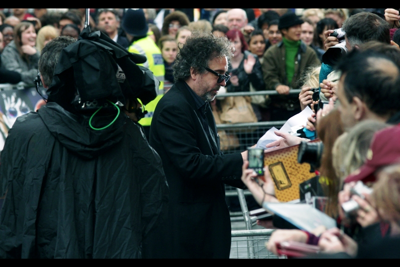 """Tim Burton!! He directed Batman (1989) Batman Returns (199...1?) (and he might even sign your kid if you're really lucky). I previously got him looking weird and unfocussed at  """"Alice In Wonderland""""  and fans of his finger being the only thing not blurry about him will love my efforts at the BAFTAs earlier this year."""