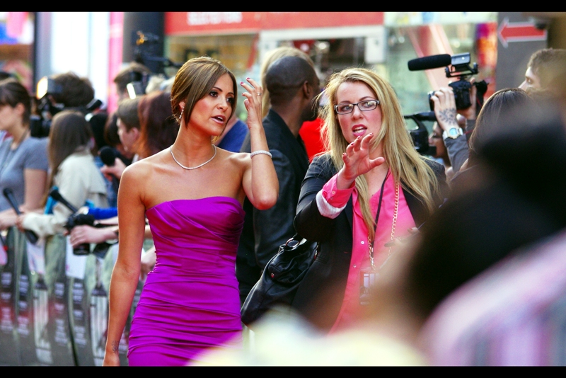 Anouska Mond (left) is in this film. And I believe her purple dress has a separate agent.