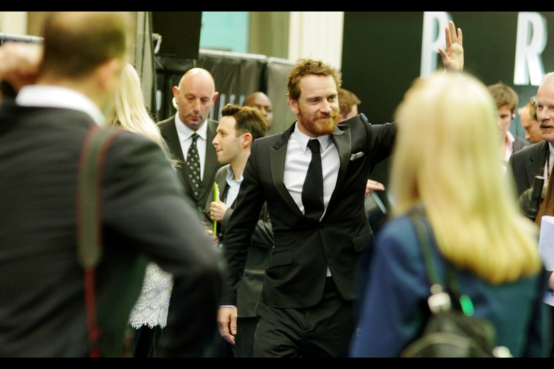 Somebody watch the girl to my right. If Fassbender waves at her she might have trouble standing again...