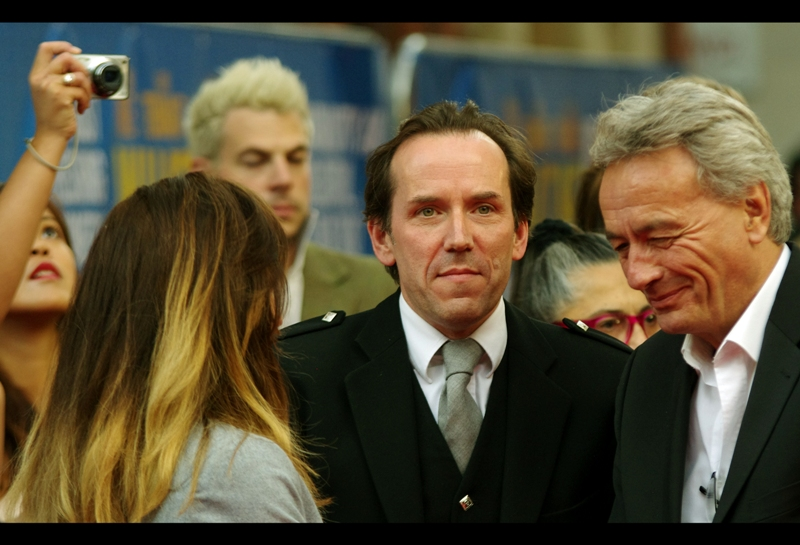 """""""They're photographing the back of my head again. Why do they do that?""""  Ben Miller's suit and tie are exquisite - and the lapels on his jacket... amazing. He's actually better known for being an actor, if you can believe it."""