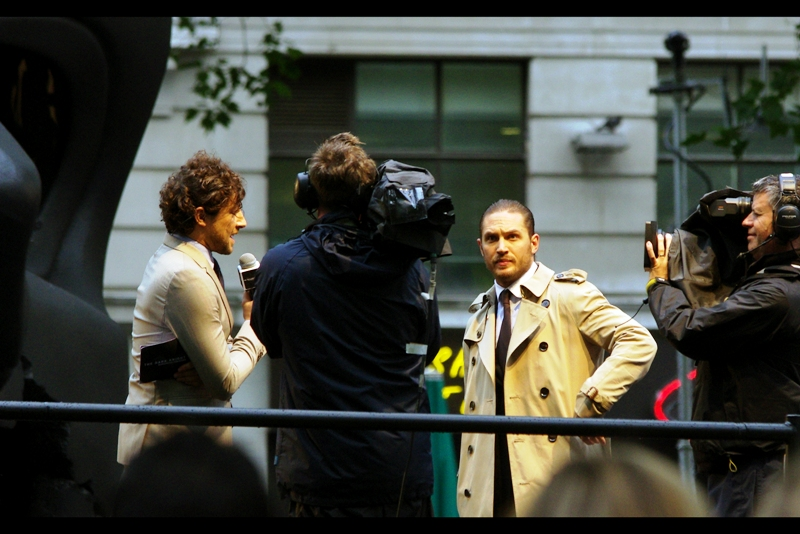 Tom Hardy was also in Inception, and he's the bad guy Bane in this film. He's also very nice in real life. And that trenchcoat looks mighty fetching, say I, as somebody who has never called a piece of clothing 'fetching' prior to this.