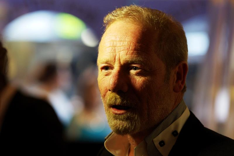"""This is not Brian Cranston. He's Peter Mullan, and he was in  Steven Spielberg's """"Warhorse""""  (he played the father of the original owner of the horse). He's apparently just been reminded of that fact, which he may have forgotten because it's like a frikkin inferno with the aircon off in a confined space."""