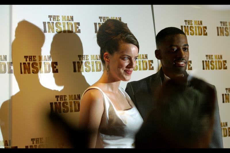"""Michelle Ryan and Ashley Thomas pose for the assembled press photographers and my camera says """"no thanks"""" to focussing through glass that has flashes going every which way."""