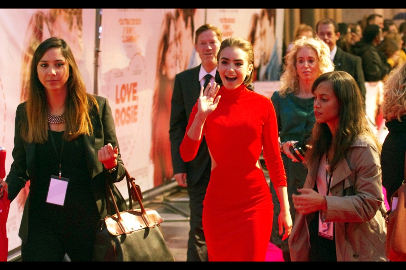 And finally, wearing a dress so red it amounts to camouflage on this carpet (and is going to destroy the white balance on my Pentax), it's Lead Actress Lily Collins