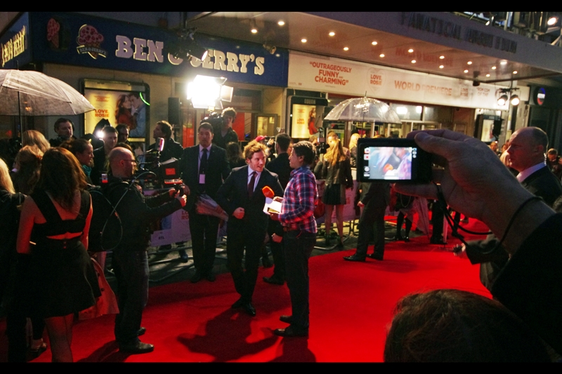"""""""Country and Western Dance-off? Right here? Bring it!""""  Sam Claflin and another man's checked shirt take to the carpet."""