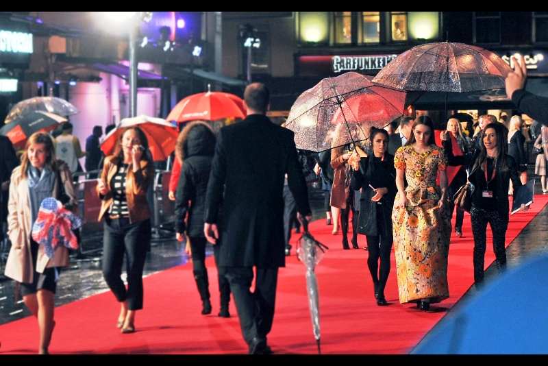 """""""If this dress gets any more waterlogged it's going to weigh more than I do, and you'll have to roll me along this red carpet"""".  The weather does seem to have turned. Welcome, as yesterday, to London in Autumn."""