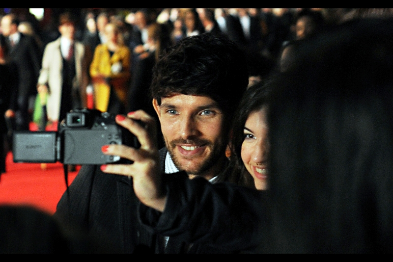 """Check it out : my screensaver is the cast of 'Now You See Me' "" ""I wasn't that kind of magician in Merlin""  Colin Morgan, in contrast, seemed happy to meet with the fans on the red carpet."