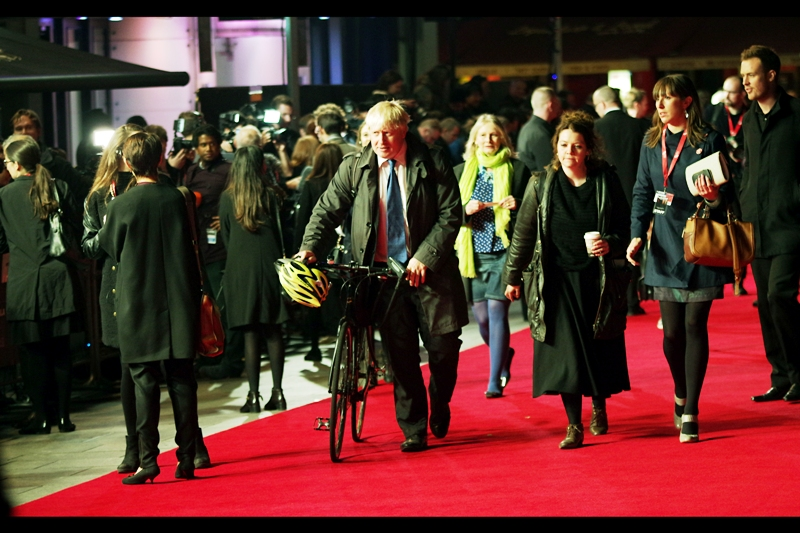 London Mayor Boris Johnson arrives, wheeling what is almost disappointingly NOT a Boris Bike up the red carpet. Mayors don't usually sign autographs, or high-five babies... and indeed neither did he.