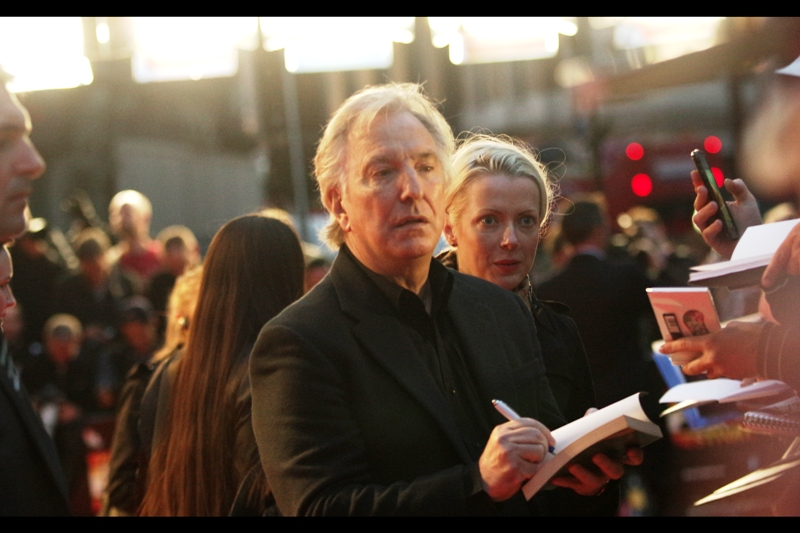 "Elsewhere on the L-Shaped Red Carpet, Alan Rickman signs for his Premiere for ""A Little Chaos"" which stars such skilled performers as Kate Winslet, Stanley Tucci, Helen McRory, Matthias Shoenaerts and... well... to be frank, Alan Rickman too."