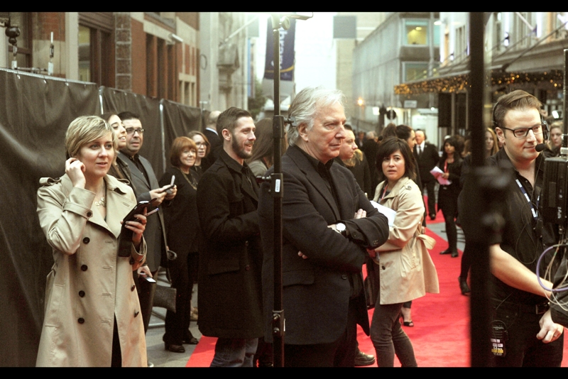 Alan Rickman glowers at the BBC as they do a couple of soundchecks, keeping him waiting on the red carpet.