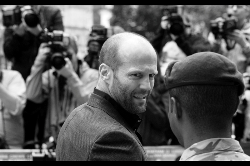 Jason Statham is momentarily taken off guard by seeing reflection of himself in the mirror. Wait, no. That's ME! Bound to happen... inevitable, really.