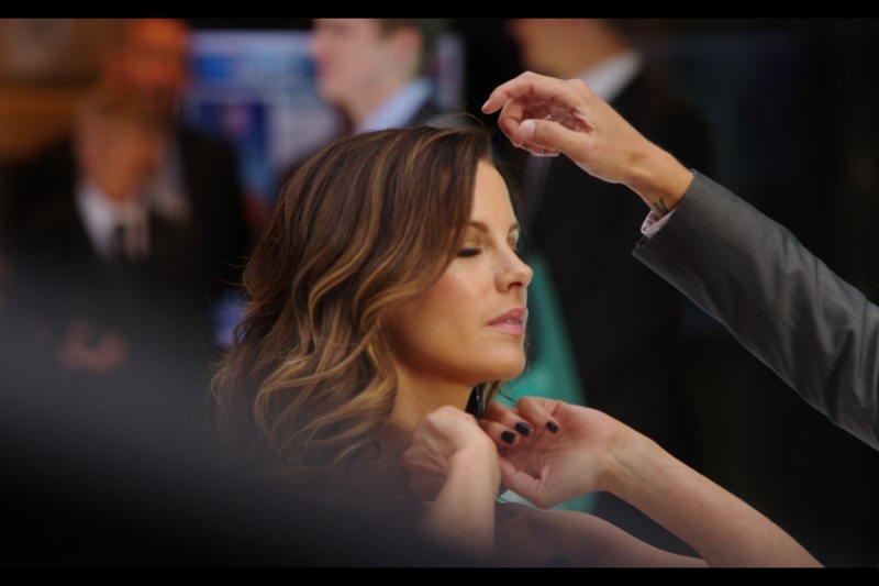 I get that he's adjusting her hair, but what's SHE adjusting?
