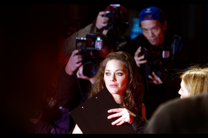 """I like Marion Cotillard, even though after three premieres I'm yet to REALLY photograph her looking as glamorous as she looks in real life. I did get some nice candids at  the end of the """"The Dark Knight Rises Premiere journal"""