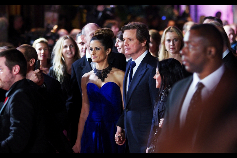 Colin Firth walked the red carpet more or less like a regular person! (meaning : he wasn't clutching his Oscar for The King's Speech or anything classless..)