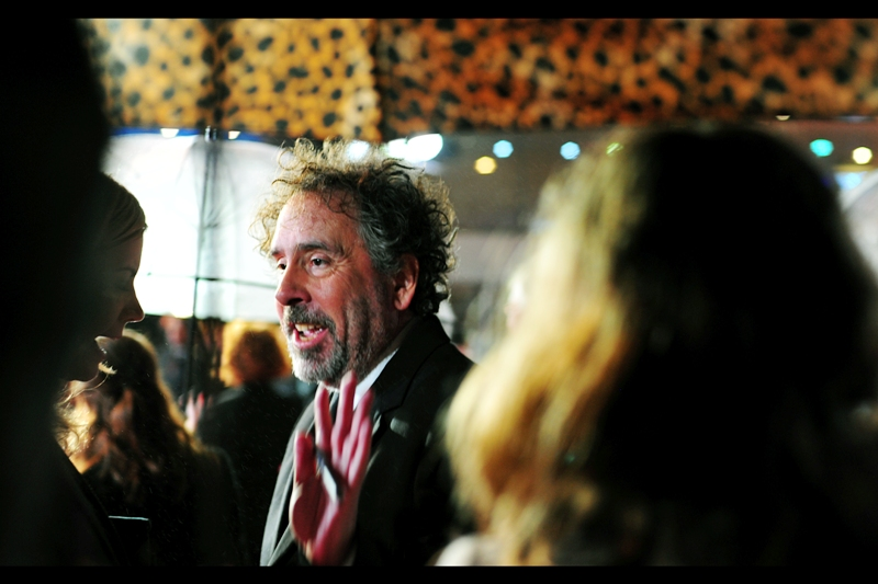 It's director Tim Burton without thick-rimmed glasses! AND a leopard print umbrella! Two great style statements together at last. He's not involved in this film, but was there to provide support for wife Helena Bonham Carter, who is.