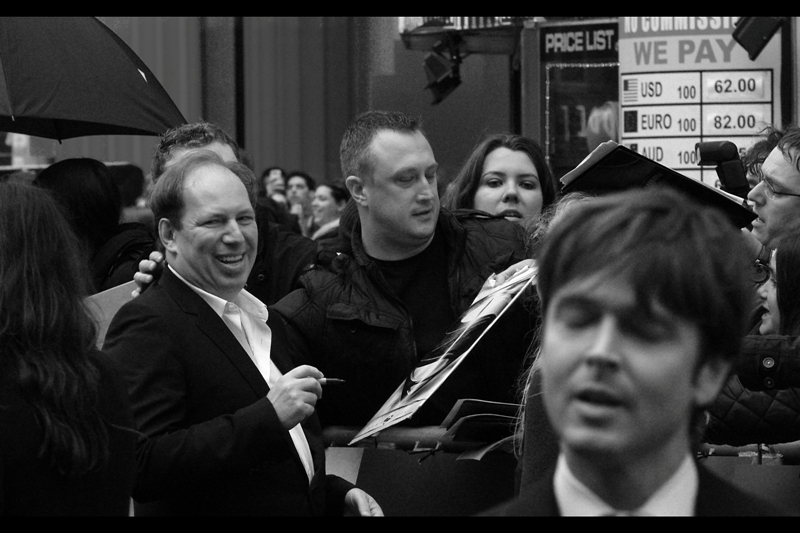 Man in front, presumably attempting to hum the Joker's theme from The Dark Knight. Hans Zimmer laughs, because it's not *really* possible. Though it is perhaps commendable.