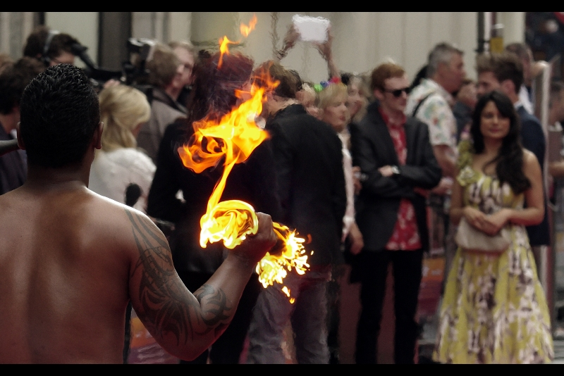 We're slowly getting into the meat of this premiere, as things are set on fire and people are walking around without t-shirts on.