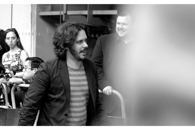 """Director Edgar Wright didn't stop to sign or even pose for the Photographers. But he'll be more cheerful next week, when it's HIS movie he'll be seeking to promote (""""The End Of The World"""")"""