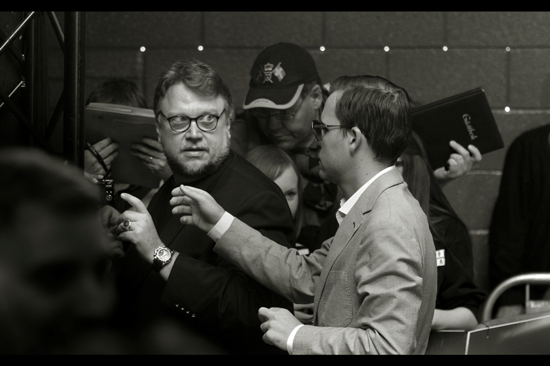 """""""Sir, you may be a lauded director, but you can't just steal some fan's camera.""""  Actually, Guillermo Del Toro was really nice - even stopping to chat with fans while signing."""