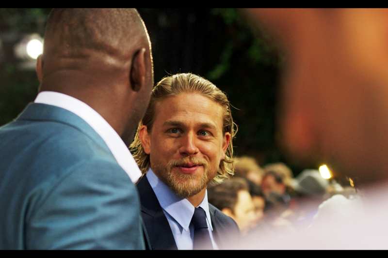 Despite the heartthrob-styled mussed up hair and hybrid BradPitt/ ChrisHemsworth/ MatthewMcConnaughey looks, Charlie Hunnam realises he can't really outcool Idris Elba, who is, after all, competing on home turf and also wearing a suit that's both bluer AND more metallic.
