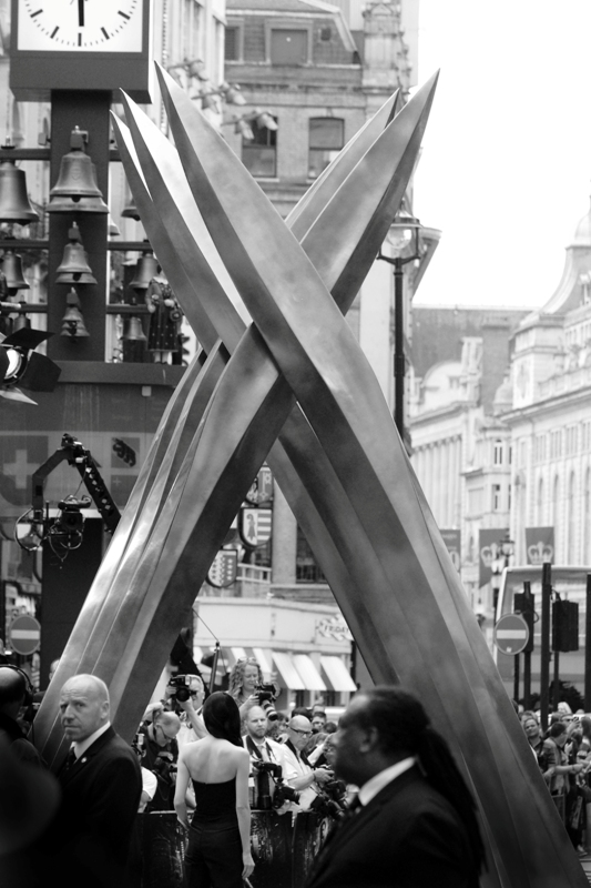 A woman standing with her back to giant crossed Adamatium claws. It could be a metaphor for something I guess. It's pretty late and I'm hydrating with some kind of liquid that I've mixed with another kind of liquid and a lot of things are looking like metaphors from where I sit. Still.. premiere. London. All good.