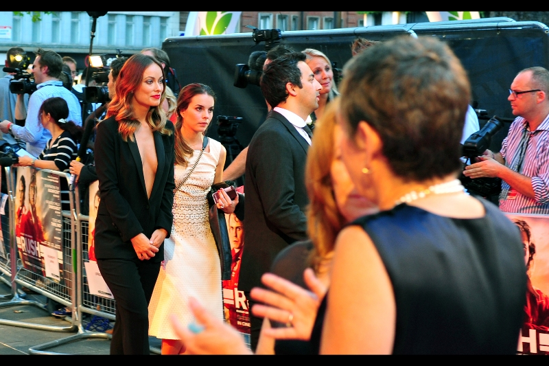 Olivia Wilde and her super-intense assistant trawl the media cordon for an acceptable quality broadcaster.