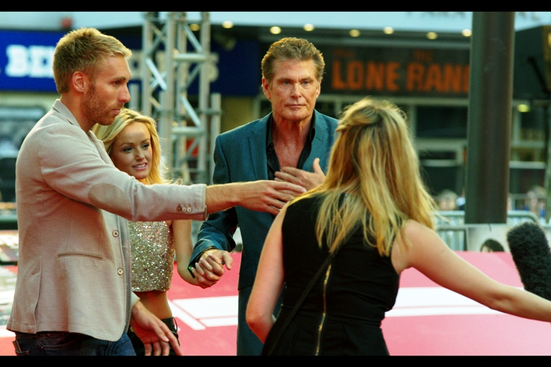 And finally, a late arrival. The Hoff and his improbably young girlfriend / assistant / granddaugther / wife.