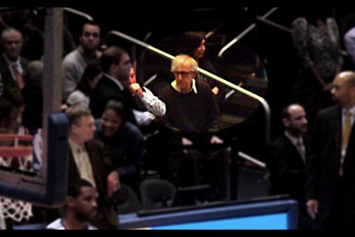 At extreme zoom in the darkness of the crowd, I'm happy enough with this photo of Woody Allen.