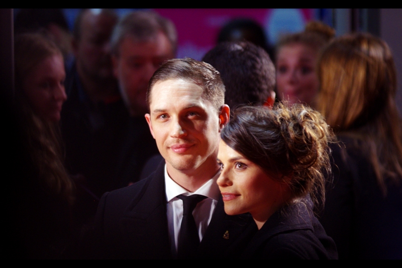 "Until then, here's Hardy with his ?girlfriend? actress Charlotte Riley, whose filmography doesn't contain anything I recognise other than the upcoming Tom Cruise / Emily Blunt film 'Edge of Tomorrow' (originally titled after the excellent Japanese novel ""All You Need is Kill""). I meanwhile am straining 10-megapixel resolution to find out what exactly the pin on Tom Hardy's lapel is."