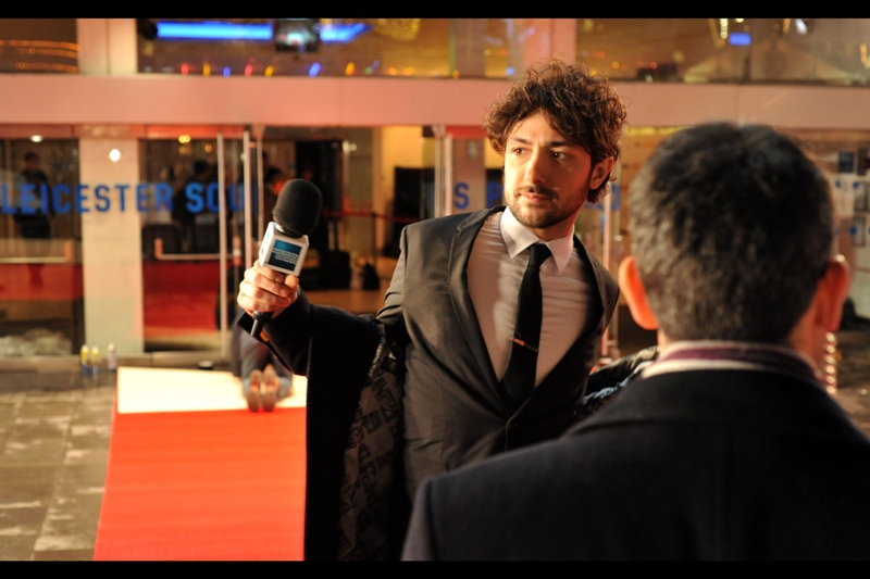 Our host for tonight is Alex Zane, who in contrast to me is taking off rather than ADDING layers.