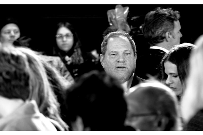 TWC Studio boss Harvey Weinstein is awash in a sea of commoners (poor guy).