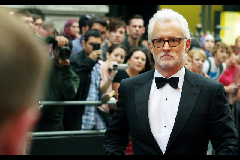 "Another human male arrives, possibly realising he's not at the Keira Knightley 'Anna Karenina' premiere. Later identified as John Slattery, who won the ""We're GQ and we can make up awards"" ""International Man"" award. Right. 7billion people on the planet. 3.5billion men, only 32million of whom live in the UK. Going to give it to a leader of men? Charity worker? Person who splits the Higgs Boson? No? An actor, then? Alrightey."