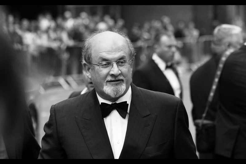 "It's Salman Rushdie! Known for : being an author, and getting death threats for writing The Satanic Verses. He won the ""Inspiration"" Award on the night. Whatever that means. I mean.... Bradley Wiggins? Did you even SEE those sideburns, GQ?? They're *Inspirational*, not a Lifetime Achievement!"