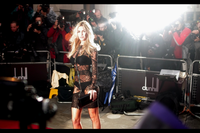 I'm a fairly conservative person in most things, however I do believe that certain people should be allowed and/or encouraged to wear some kind of zipper/lace dress out in public. And here is one! (Model Abbey Clancey is married to soccer/football player Peter Crouch. The Paps on the other side were backlighting her at the same time as the Paps on MY side were photographing her from in front, so this photo is kind of compromised) (That said, is it a Photo for the Day candidate over Keith Richards? Yes... yes it is!)